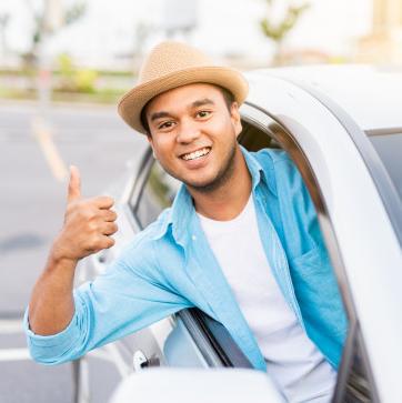 young-asian-man-smiling-showing-thumb-up-his-car_109959-2.jpg